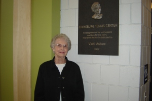 Askew, at the 2007 inauguration, posing with the plague that is hung in her honor at the tennis center.